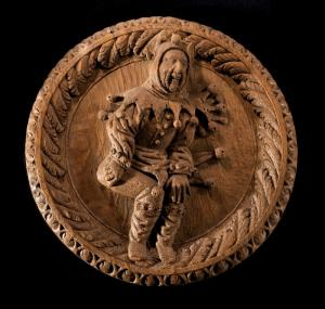 16th-century carved oak roundel of a jester from the King's Presence Chamber at Stirling Castle, Scotland.